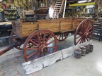 restored single sided farm wagon  with old side board and hubs